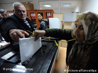 A woman in Kosovo casts her vote