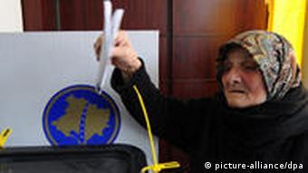 voter casting ballot