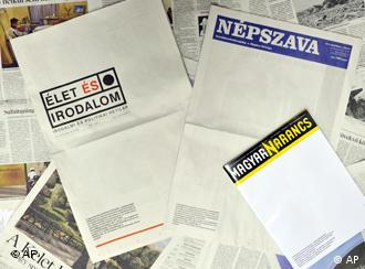 Three Hungarian newspapers and magazines are arranged with their front-pages published blank