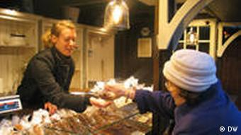 Jennifer Bohne sells some toasted nuts to a customer