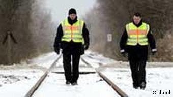 Police walking along railroad tracks