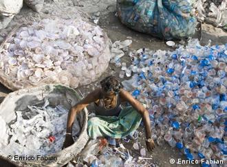 An Indian waste collector sorting plastic bottles