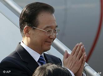 The Chinese Premier greets his hosts in an Indian way after arriving in New Delhi
