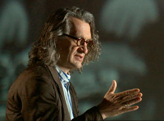 Wim Wenders gestures with his hands while speaking