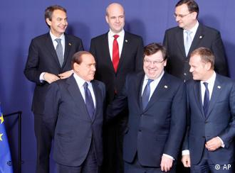 From left to right, Spain's Prime Minister Jose Luis Rodriguez Zapatero, Italy's Prime Minister Silvio Berlusconi, Swedish Prime Minister Fredrik Reinfeldt, Irish Prime Minister Brian Cowen, Czech Republic's Prime Minister Petr Necas and Poland's Prime Minister Donald Tusk during a group photo at the EU summit