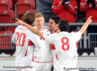 Four Stuttgart players celebrate their fifth and final goal of the night