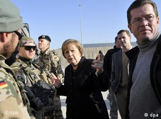 Merkel and zu Guttenberg address the troops in Afghanistan