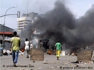 Smoke fills a street in Abidjan