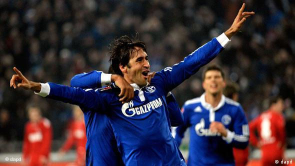 Raul with arms outstretched, celebrating a goal