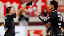 Munich's Franck Ribery, left, and Mario Gomez celebrate their side's 3rd goal during the German first division Bundesliga soccer match between VfB Stuttgart and Bayern Munich in Stuttgart, Germany, Sunday, Dec.19, 2010. (AP Photo/Michael Probst) **NO MOBILE USE UNTIL 2 HOURS AFTER THE MATCH, WEBSITE USERS ARE OBLIGED TO COMPLY WITH DFL-RESTRICTIONS, SEE INSTRUCTIONS FOR DETAILS **