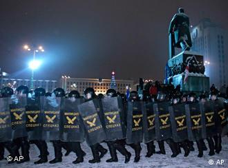 Riot police forming a barrier against protesters in Minsk on December 20 2010