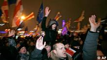 Opposition supporters shout slogans during a rally in Minsk, Belarus, early Monday, Dec. 20, 2010. Thousands of opposition supporters in Belarus tried to storm the main government building to protest what the opposition claims was large-scale vote-rigging in Sunday's presidential election. (AP Photo/Dmitry Brushko)