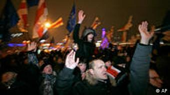 Opposition supporters shout slogans during a rally in Minsk