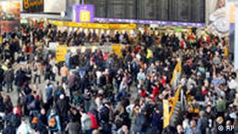 Hundreds of passengers queue in a departure terminal at the international airport of Frankfurt