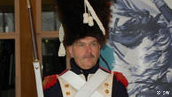 Close-up of a man dressed like one of Napoleon's soldiers at the Bundeskusnthalle in Bonn.