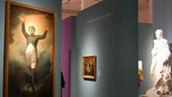 Picture of Napoleon exhibition, showing a painting of Napoleon, a female sculpture and another small painting in the back.