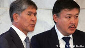 Almazbek Atambayev (L) and Ata-Zhurt nationalist party leader Akhmatbek Keldibekov (R)