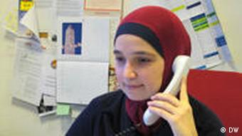 Woman in headscarf on telephone