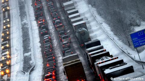 Cars and trucks queue up along a motorway outside of Cologne in Germany. Photo: Julian Stratenschulte dpa/lnw