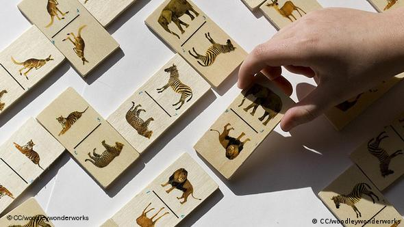 A wooden board game with pictures of animals