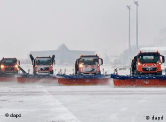 Plows clear an airport runway