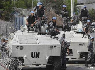 UN forces patrol a street near to Ouattara's headquarters