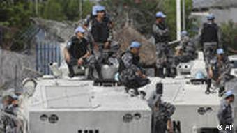 UN forces patrol outside the UN headquarters in Ivory Coast