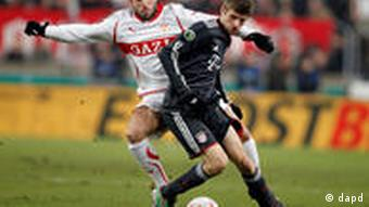 Stuttgart's Cristian Molinaro with Bayern's Thomas Mueller, on the ball