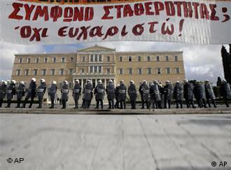 Riot police guard the Greek parliament