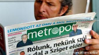 A man reading a Hungarian newspaper