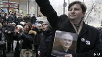 Khodorkovsky supporters hold his picture outside the courtroom