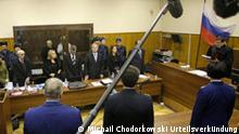 Judge Viktor Danilkin, right, reads a verdict at a court room in Moscow, Russia, Monday, Dec. 27, 2010. The judge on Monday declared former oil tycoon Mikhail Khodorkovsky guilty of theft and money laundering charges in his second trial, Russian news agencies reported, a verdict that would likely keep Russia's once richest man behind bars for several more years. (AP Photo/Sergey Ponomarev)