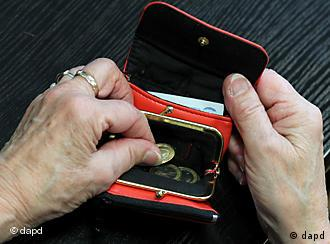 Hands reaching into a coin purse