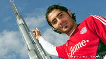 Hamit Altintop in front of the Burj Khalifa tower
