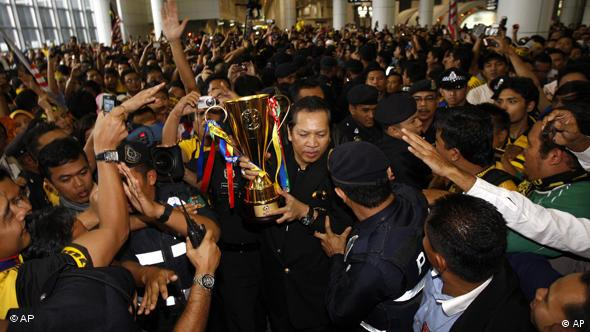 Hundreds of fans crowded the airport in Kuala Lumpur to receive the winning team on Thursday