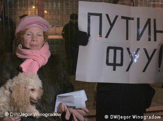 Russian woman next to a protest sign