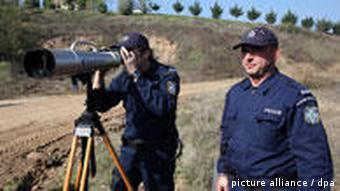 Greek police officers patrol the Greek-Turkish borders