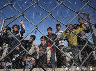 Illegal immigrants are seen in a detention center in Kyprinos