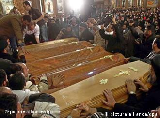 Egyptian Christians attending to the coffins of the bombing victims