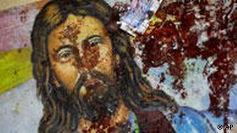 A blood-spattered poster of Jesus Christ inside the Coptic church in Alexandria