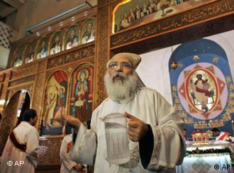 A Coptic priest during the morning mass inside the Saints Church in Alexandria, Egypt