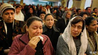 Egyptian Coptic Christians attend morning mass inside the Saints Church in Alexandria