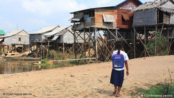 A child walking through a small village near Chong Khneas, Cambodia.