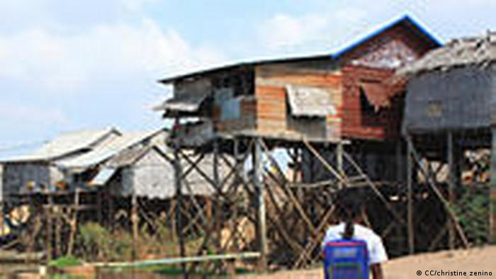 Young Cambodian girl returns home to slums from school