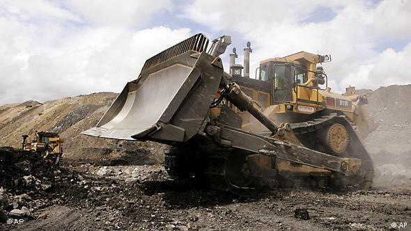 A Caterpillar D11 and a D10 work at a coal mine near Gloucester, Australia