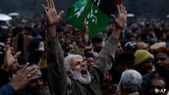 A Pakistani mourner reacts during the funeral procession of Punjab Gov. Salman Taseer, in Lahore, Pakistan, Wednesday, Jan. 5, 2011. Thousands of Pakistani police were on high alert in Lahore on Wednesday ahead of the funeral for an outspoken provincial governor shot dead by a bodyguard reportedly enraged by his opposition to laws decreeing death for insulting Islam. Punjab Gov. Salman Taseer, a high-profile, 66-year-old businessman and media tycoon, was a stalwart of the ruling Pakistan People's Party, and his assassination Tuesday sent nuclear-armed Pakistan reeling at a time of great political turmoil.(AP Photo/Muhammed Muheisen)