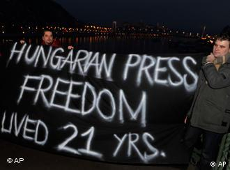 Hungarian activists hold a banner over the river Danube