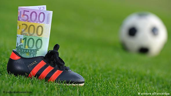 A football shoe filled with euro notes