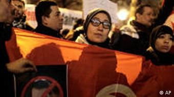 Demonstrators stage a protest to calling for the resignation of Tunisian President Zine El Abidine Ben Ali, featured on posters, in Paris, Thursday Jan. 6, 2011. A young Tunisian who died after setting himself alight in Sidi Bouzid in a protest over unemployment sparked a wave of unrest and clashes that rattled the government in tightly controlled Tunisia. Placard reads: Down with the Tunisian dictators. (AP Photo/Thibault Camus