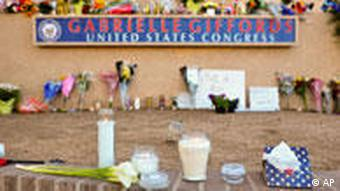 Flowers and candles outside US congresswoman Gabrielle Giffords' office